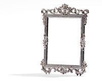 Empty vintage decorative silver frame, on white Stock Image
