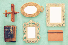 Empty vintage frames ready for mockup, old books and airplane toy. Top view image of empty vintage frames ready for mockup, old books and airplane toy over Stock Image