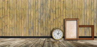 Empty vintage frames and watch against an wooden wall stock images