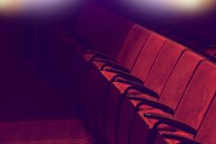 Empty vintage red seats in theater auditorium Stock Photo