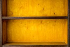 Empty vintage shelves. Old wooden racks, bookshelves Royalty Free Stock Photos