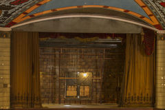 Empty vintage stage. Emtpy stage with open curtains in 1920's era movie theater Stock Photography