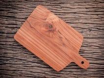 Empty vintage Teak wood cutting board on grunge wood food backgr Stock Image