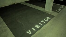 Empty visitors parking spots in an underground parking garage