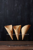 Empty waffle cones. For ice cream in a plastic stand Royalty Free Stock Photos
