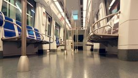 Empty Wagon Of A Metro Train With Blue Seats. Barcelona, Spain - April 8, 2017: Metro System in Barcelona City. Empty Wagon Of A Metro Train With Blue Seats stock video