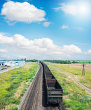 Empty wagons on railroad under blue sky Royalty Free Stock Photos
