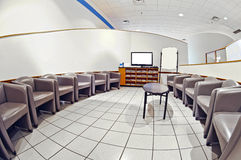 Empty Waiting Room With Blank TV and White Sign Revised Royalty Free Stock Photography