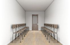 Empty Waiting Room Chairs And Office Door royalty free stock image