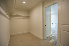 Empty walk-In closet in master bedroom bathroom in model home in San Diego California Stock Photo