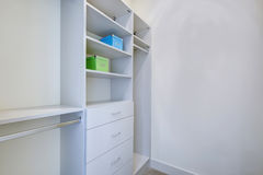 Empty walk-in closet with open shelves. And grey carpet floor. Northwest, USA stock photos