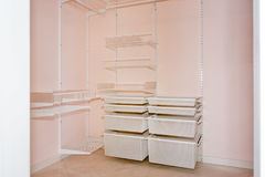 Empty walk-in closet with shelves. Dressing room Interior elements. Royalty Free Stock Image