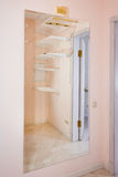 Empty walk-in closet with shelves. Dressing room Interior elements. Royalty Free Stock Images