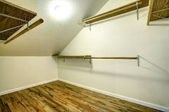 Empty walk-in closet with vaulted ceiling Stock Photo