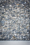 Empty wall made of stones and concrete pavement Stock Photo