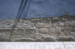 Empty wall in mediterranean city. Diffrent layers of stone and plaster textures on empty painted wall Royalty Free Stock Images