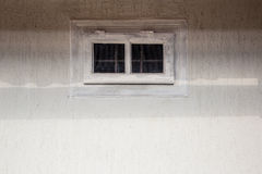 Empty wall with small window Detail of house exterior wall. Stock Image