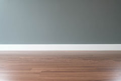 empty wall with a wooden floor below Stock Image