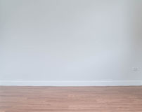 empty wall with a wooden floor below Stock Photo