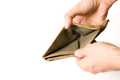 Empty wallet. Man holding out an empty wallet expressing poverty Royalty Free Stock Photo