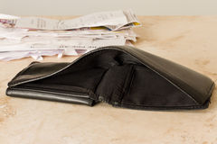 Empty wallet. With a stack of bills in the back royalty free stock photos