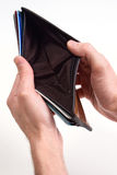 Empty wallet. Hands hold out an dempty wallet royalty free stock photo