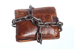 Empty wallet in chain - poor economy, end of spending. End of personal spending. Poor economy represented by empty wallet in chain isolated on white Royalty Free Stock Photo