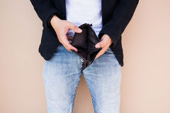 Empty wallet in the hands of a freelancer. Stock Image