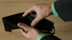 Empty wallet in the hands of a man stock footage