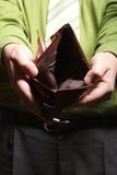 Empty wallet in male hands - poor economy. Poor economy represented by empty wallet in businessman's hands stock images