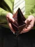Empty wallet in male hands - poor economy Royalty Free Stock Images