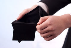 Empty wallet. Man with an empty black wallet Royalty Free Stock Photo