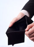 Empty wallet. Man with an empty black wallet Royalty Free Stock Photos