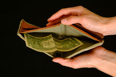 Empty wallet with one dollar on black background Stock Photos