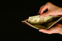 Empty wallet with one dollar on black background Royalty Free Stock Image