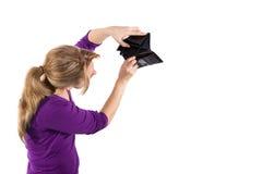 Empty wallet. Woman showing an empty wallet Stock Photo