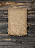 Empty wanted poster on plank wood wall Royalty Free Stock Photo