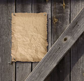 Empty Wanted poster on weathered plank wood door Stock Image