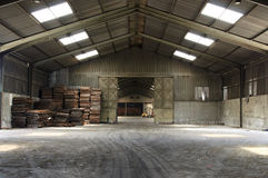Empty warehouse. Rusty old pallets in abandoned warehouse Stock Photography