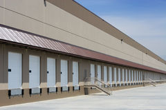 Empty Warehouse. Loading dock with closed bays royalty free stock photography