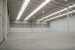 Empty warehouse. For industrial purposes illuminated by solar light Royalty Free Stock Photos