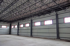 Empty warehouse. Large modern  empty warehouse interior Royalty Free Stock Photos