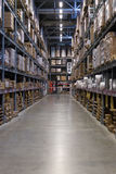 Empty Warehouse Racking with Floor Space. Warehouse racking with nobody and stacked up products Stock Photos