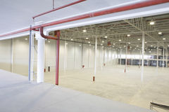 Empty Warehouse With Red Piping Royalty Free Stock Photos