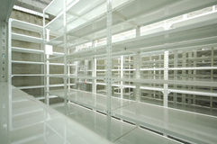 Empty warehouse, storage  racks Royalty Free Stock Photos