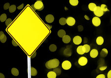 Empty warning sign with abstract yellow lights Stock Image