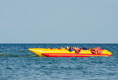 Empty water banana, with lifejackets in sea water attraction.  stock image