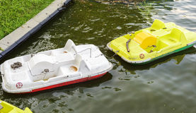 Empty water bicycles on lake Stock Images