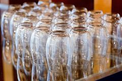 Empty water glasses line for coffee break function Royalty Free Stock Images