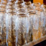 Empty water glasses line for coffee break function Stock Image